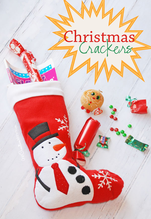 Too much candy in the Christmas stocking because Santa is trying to give to give the kids all of their favorites? Mix it up (literally). Try these adorable Christmas Crackers Stocking Stuffers! {OneCreativeMommy.com} Simple tutorial
