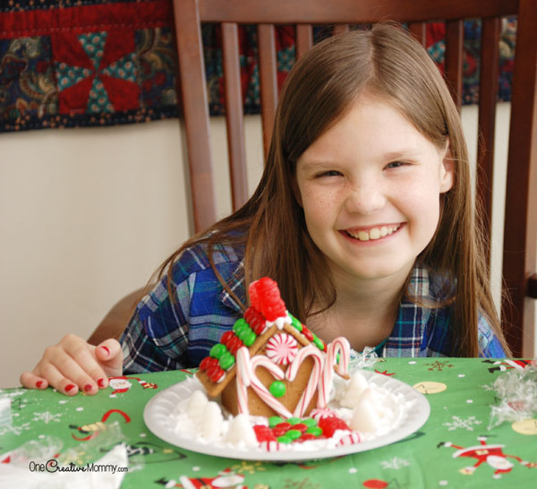 Check out these genius hacks to create a gluten free Gingerbread House in minutes! {OneCreativeMommy.com} Works with non-gluten-free houses, too.